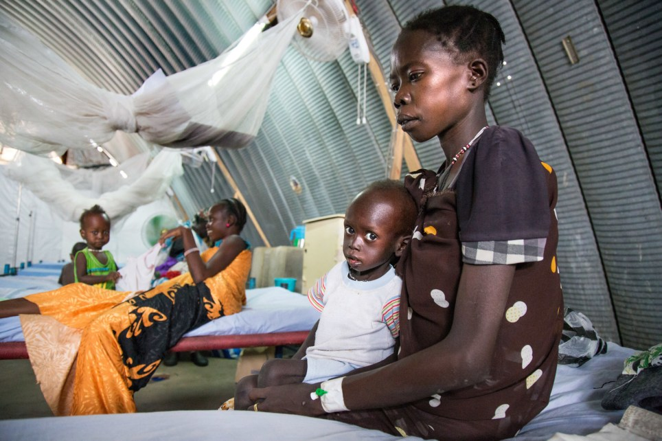 Lomong Latabu holds her son Khamis Tuth who is severely malnourished, Juba, South Sudan (Picture: UNICEF)