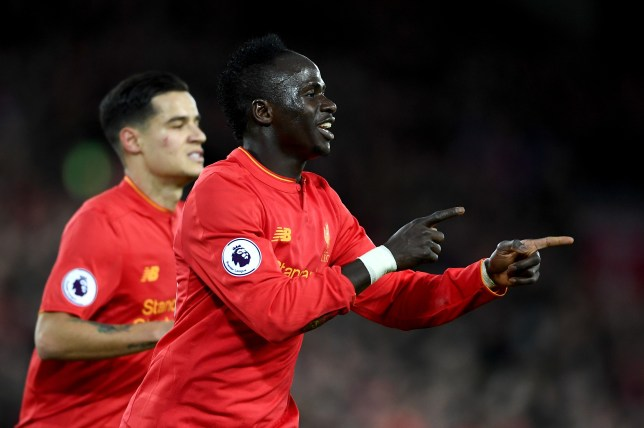 LIVERPOOL, ENGLAND - MARCH 04: Sadio Mane of Liverpool celebrates scoring his sides second goal during the Premier League match between Liverpool and Arsenal at Anfield on March 4, 2017 in Liverpool, England. (Photo by Laurence Griffiths/Getty Images)