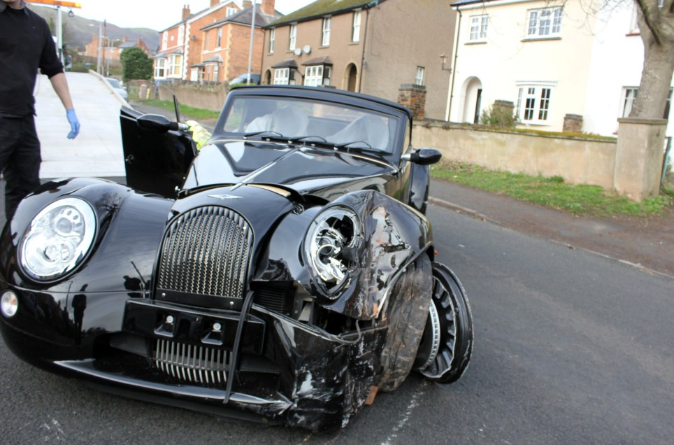 A Morgan sports car has been 'written off' after crashing through a wall and into a campervan, according to a resident. The campervan owner's plans to go on a family holiday in the van later this month now look unlikely after his vehicle was heavily damaged in the incident. It is thought that a Morgan test driver was behind the wheel when it crashed. The incident happened at about 8.45am this morning (March 1) in Madresfield Road, Malvern, just a few miles from the Morgan factory. Morgan confirmed that the Aero 8, which has a starting price of £85,000, was from the factory in Pickersleigh Road, Malvern.
