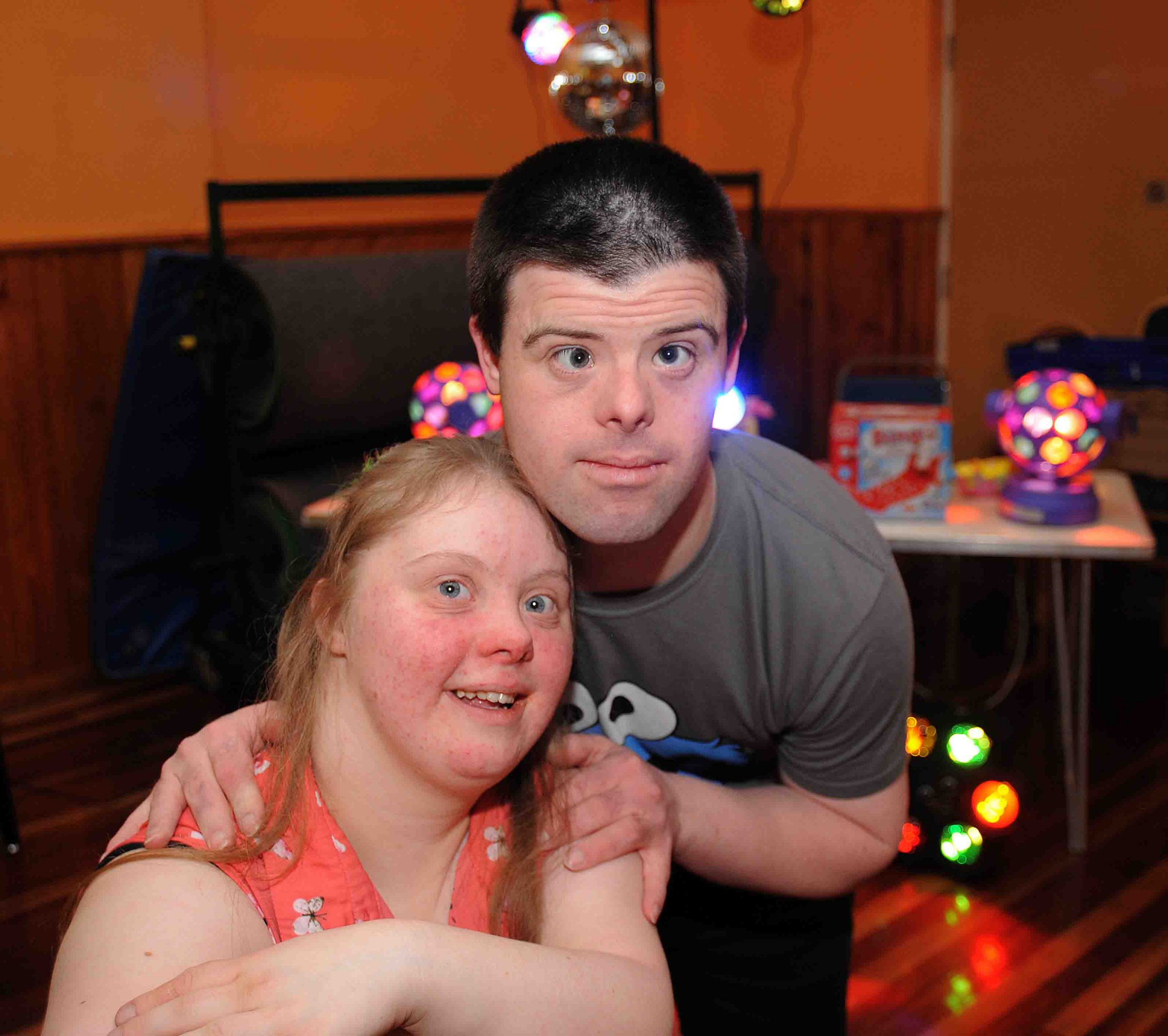 When two young love-struck adults with Down¿s Syndrome were told their kissing at a youth club was ¿inappropriate¿, their mums set up a club for adults with disabilities.nLove blossomed between Niki Wyatt and Samantha Lochrie, who both have Downs Syndrome, after they met at a youth club for people with disabilities.nBut when the pair shared a kiss, they were told their behaviour was unacceptable by staff ¿ despite Niki and Samantha both being aged over 18 at the time.nThat was when their mums and full-time carers, Jackie Wyatt and Kim Lochrie, stepped in and founded a social club in Thornaby that specifically caters for the needs of disabled adults.nnNews. 1st Anniversary of the JK Club at the Robert Atkinson Centre, Thornaby. Jackie Wyatt's son Niky and Kim Lochrie's daughter Samanthann* With Video *