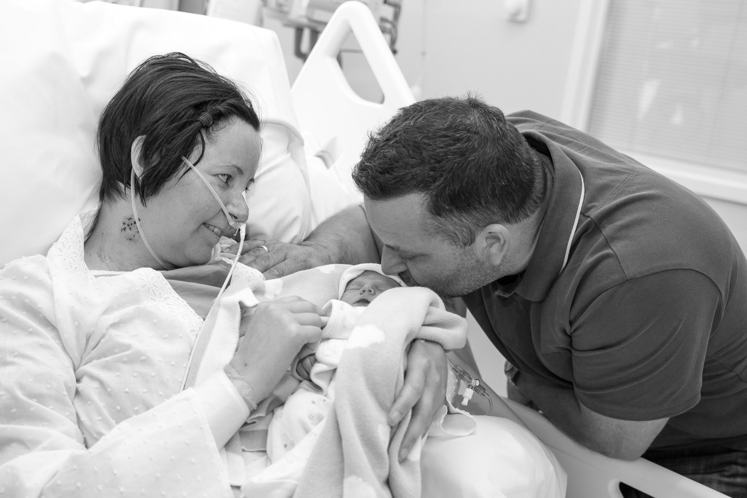 PIC FROM REMEMBER MY BABY/MERCURY PRESS (PICTURED: KERRY TELLWRIGHT, 34, WITH HER FIANCE CRAIG HILL AND THEIR STILLBORN SON AFTER SHE AWOKE FROM A COMA AT THE QUEEN ELIZABETH HOSPITAL IN BIRMINGHAM) A brave mum has shared heartbreaking photos taken¿with her stillborn son after she awoke from a coma to told he had been dead for THREE¿WEEKS. Kerry Tellwright, 34, and her fiancÈ Craig Hill, 47, were ëover the mooní when they found out they were expecting¿after eight years of trying, two rounds of¿IVF and an early miscarriage of twins. However despite a normal pregnancy, in her¿38th¿week Kerry¿started to experience pain in her left shoulder that ëfelt like a trapped nerveí. SEE MERCURY COPY