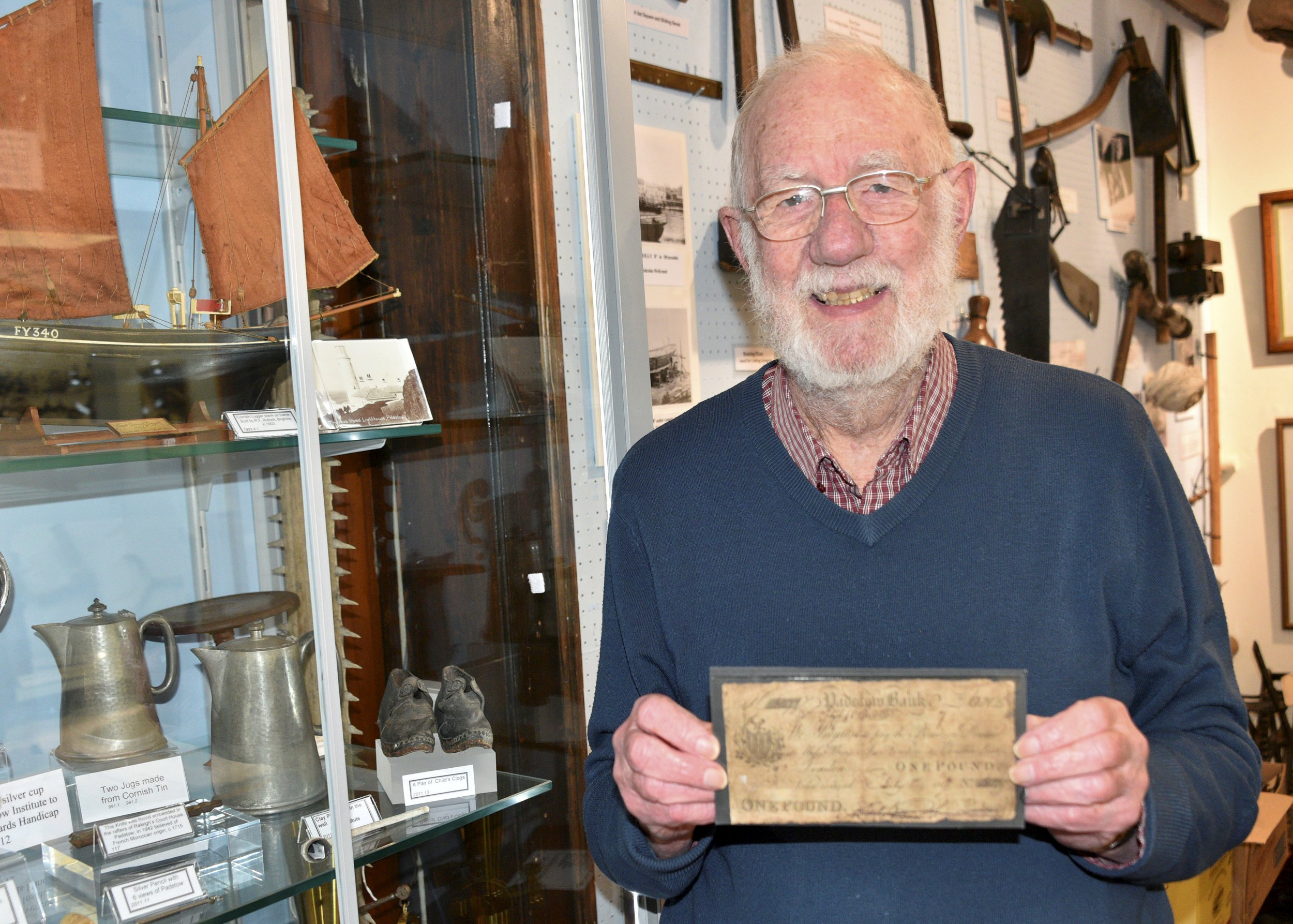 """John Buckingham with the 200 year old bank note. See SWNS story SWNOTE: Intrigue turned to astonishment for John Buckingham when an exotic letter which dropped on his doormat turned out to contain a rare 200-year-old Padstow Bank note stolen from a museum more than 30 years ago. The simple white envelope, dotted with colourful Caribbean stamps, had no return address and was addressed in handwriting to the care of the Padstow Museum. As chairman, Mr Buckingham had carefully opened the correspondence, wondering who was reaching out to their little collection of antiquities from across the ocean. """"I was very surprised,"""" he said. """"When I saw the envelope and the postmark I first thought, 'who is writing to me from St Lucia?' I just opened it and there was no covering letter or anything. There was a plastic sleeve, like the type a collector might use, and inside was this £1 note."""""""