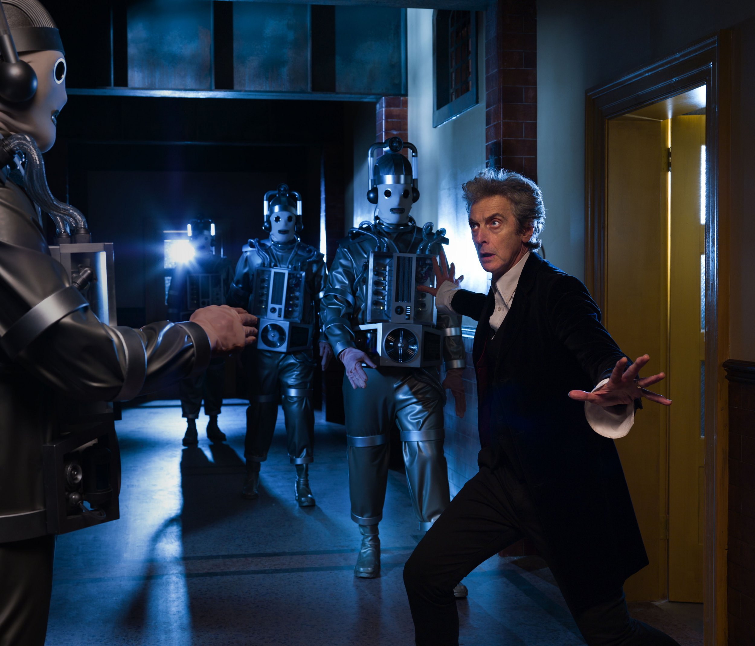 For use in UK, Ireland or Benelux countries only Undated BBC handout photo of Peter Capaldi as Doctor Who with Mondasian Cybermen - a classic enemy that has not been seen on the show for more than 50. PRESS ASSOCIATION Photo. Issue date: Monday March 6, 2017. The creepy masked creatures, which Capaldi has described as his favourite Doctor Who foe, will return in episodes 11 and 12 of the 10th series.Filming of the episodes, written by Steven Moffatt and directed by Rachel Talalay, is currently under way in Cardiff. See PA story SHOWBIZ DoctorWho. Photo credit should read: Simon Ridgway/BBC/PA Wire NOTE TO EDITORS: Not for use more than 21 days after issue. You may use this picture without charge only for the purpose of publicising or reporting on current BBC programming, personnel or other BBC output or activity within 21 days of issue. Any use after that time MUST be cleared through BBC Picture Publicity. Please credit the image to the BBC and any named photographer or independent programme maker, as described in the caption.