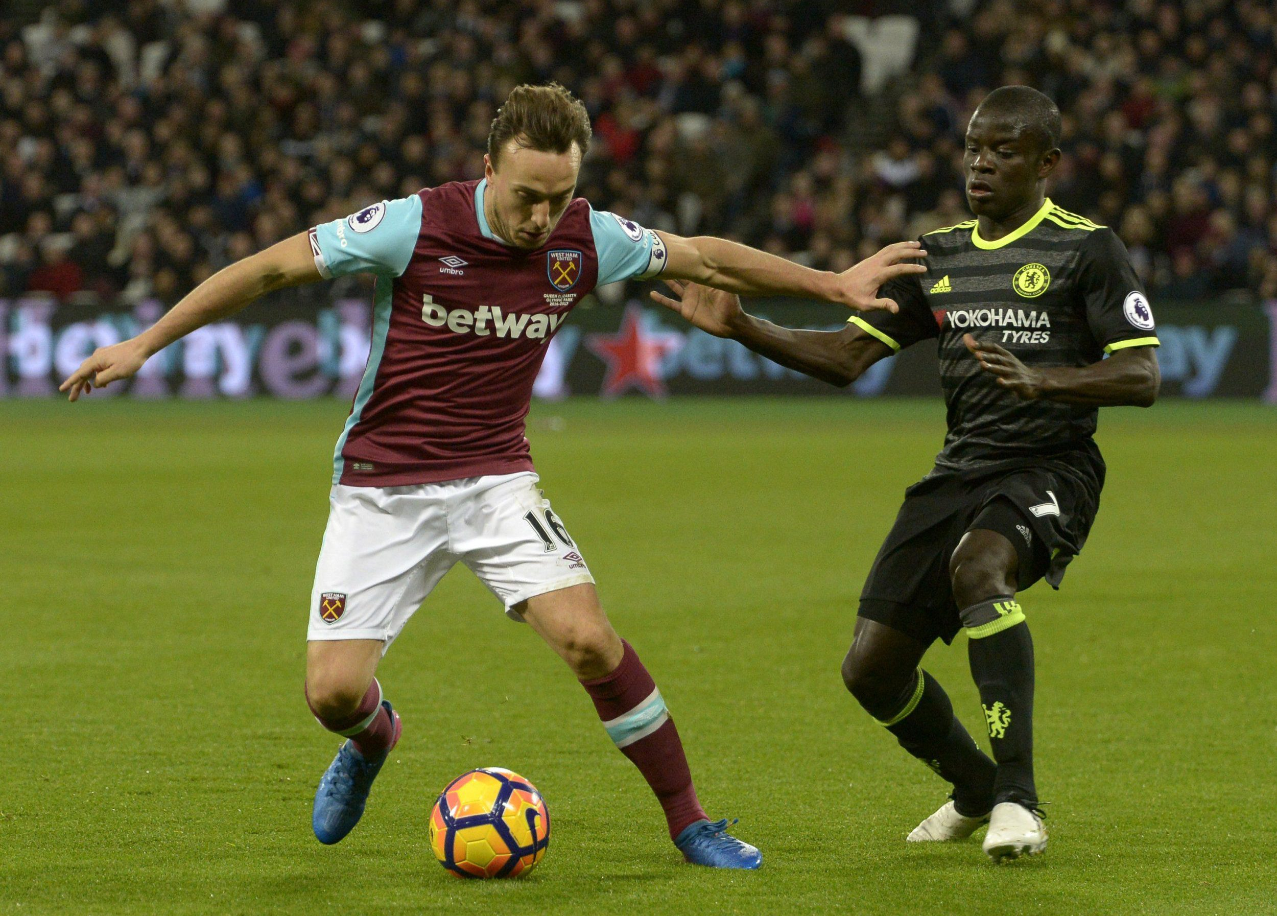 STRATFORD, ENGLAND - MARCH 06: Mark Noble of West Ham United in action with N'Golo Kante of Chelsea during the Premier League match between West Ham United and Chelsea at London Stadium on March 6, 2017 in Stratford, England. (Photo by Arfa Griffiths/West Ham United via Getty Images)