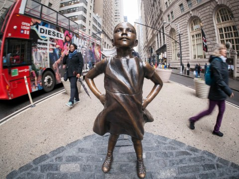 A statue of a fearless girl is staring down the charging bull of Wall Street