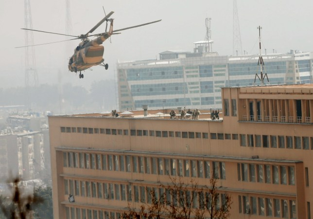 Afghan National Army (ANA) soldiers descend from helicopter on a roof of a military hospital during gunfire and blast in Kabul, Afghanistan March 8, 2017.REUTERS/Mohammad Ismail