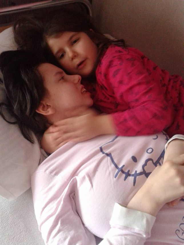 """Pic shows: Danijela Kovacevic with her daughter.nnA woman who went into a coma following a traumatic labour seven years ago has startled doctors by waking up.nnDanijela Kovacevic gave birth to a baby girl in 2009 and went into a coma after contracting blood poisoning.nnThe 25-year-old, from Indjija in the province of Vojvodina in the northern part of Serbia, gave birth to her daughter Marija, in the hospital in the city of Novi Sad but contracted sepsis and because of the inflammation, fell into a coma and since then had remained in a vegetative state but with her eyes open.nnIt is reported she is longest survivor of being in that type of coma in the country but doctors have been left astounded as she has awoken and has started to slowly respond to treatment.nnDoctors say she can now hold a tablet and pen in her hand as well as sit up and follow conversations.nnHer dad, Djordje Kovacevic, said: """"These are minor recoveries, but Danijela is much better that before. She has put on weight, she is more aware and more alive. She reacts, smiles and also gets angry.""""nnIn a rehabilitation centre in Germany, Danijela is doing physical and specialist speech therapies that stimulate the function of brain cells.nnThe family needs a further 50,000 EUR (43,000 GBP) for her treatment to continue.nnHer dad said: """"The recovery of three months is really short. A man who breaks an arm needs more than three months of recovery, imagine how much time my daughter needs.nn""""That is because you are teaching a kid to do certain things. She had very hard trainings. She walked 800 metres and that is a big achievement.""""nnFriends and family have started a collection for Danijela¿s treatment, but he fears it will not be enough.nnMr Kovacevic said: """"They organised a competition in taekwondo and all the money they gathered was for Danijela¿s recovery. They gave us 10,000 EUR (8,700 GBP), but we need 50,000 more.""""nn(ends)"""
