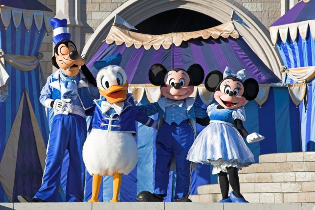 Mickey and Minnie Mouse on stage with Goofy and Donald Duck, Magic Kingdom, Orlando, Florida, USA