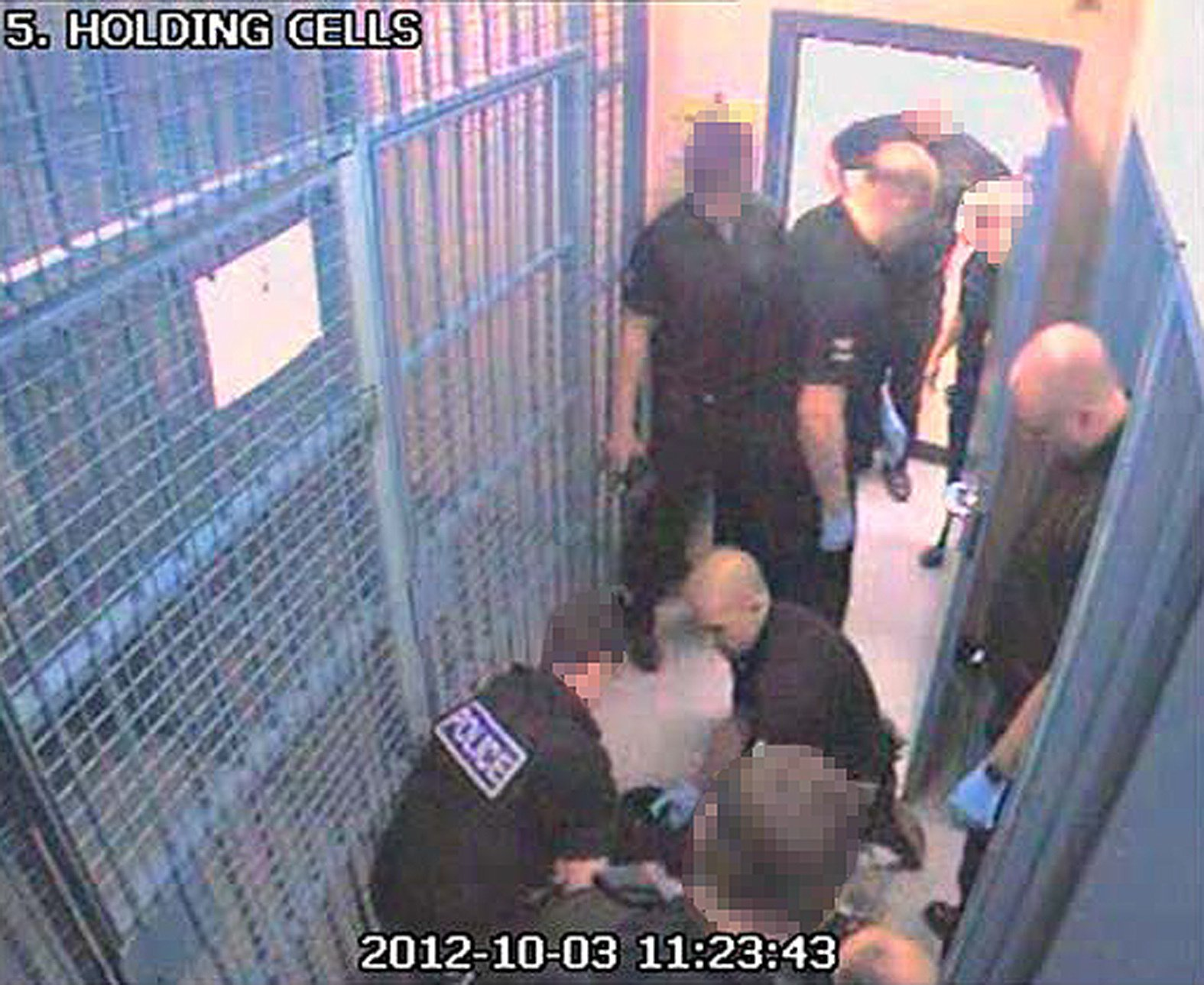 EDITORS NOTE IMAGE PIXELATED AT SOURCE BEST QUALITY AVAILABLE CCTV still issued by the Independent Police Complaints Commission of Simon Tansley, (right kneeling), and Michael Marsden (right) with Thomas Orchard on the floor of the holding cells at Heavitree Road police station. Custody sergeant Kingshott and detention officers Tansley and Marsden of Devon and Cornwall Police have been found not guilty at Bristol Crown Court of the manslaughter of Orchard, who died after being restrained in Exeter in 2012. PRESS ASSOCIATION Photo. Issue date: Wednesday February 15, 2017. See PA story COURTS Restrain. Photo credit should read: IPCC/PA Wire NOTE TO EDITORS: This handout photo may only be used in for editorial reporting purposes for the contemporaneous illustration of events, things or the people in the image or facts mentioned in the caption. Reuse of the picture may require further permission from the copyright holder.