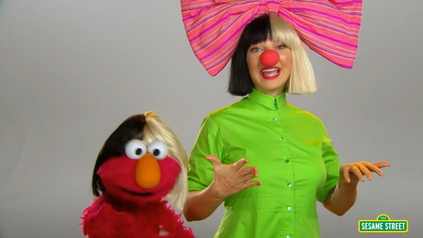 Sia sings about songs with Elmo and Cookie Monster on Sesame Street