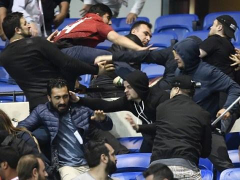 Chaos in Lyon ahead of Europa League tie as fans flood pitch and fight in stands after Besiktas ultras throw firecrackers