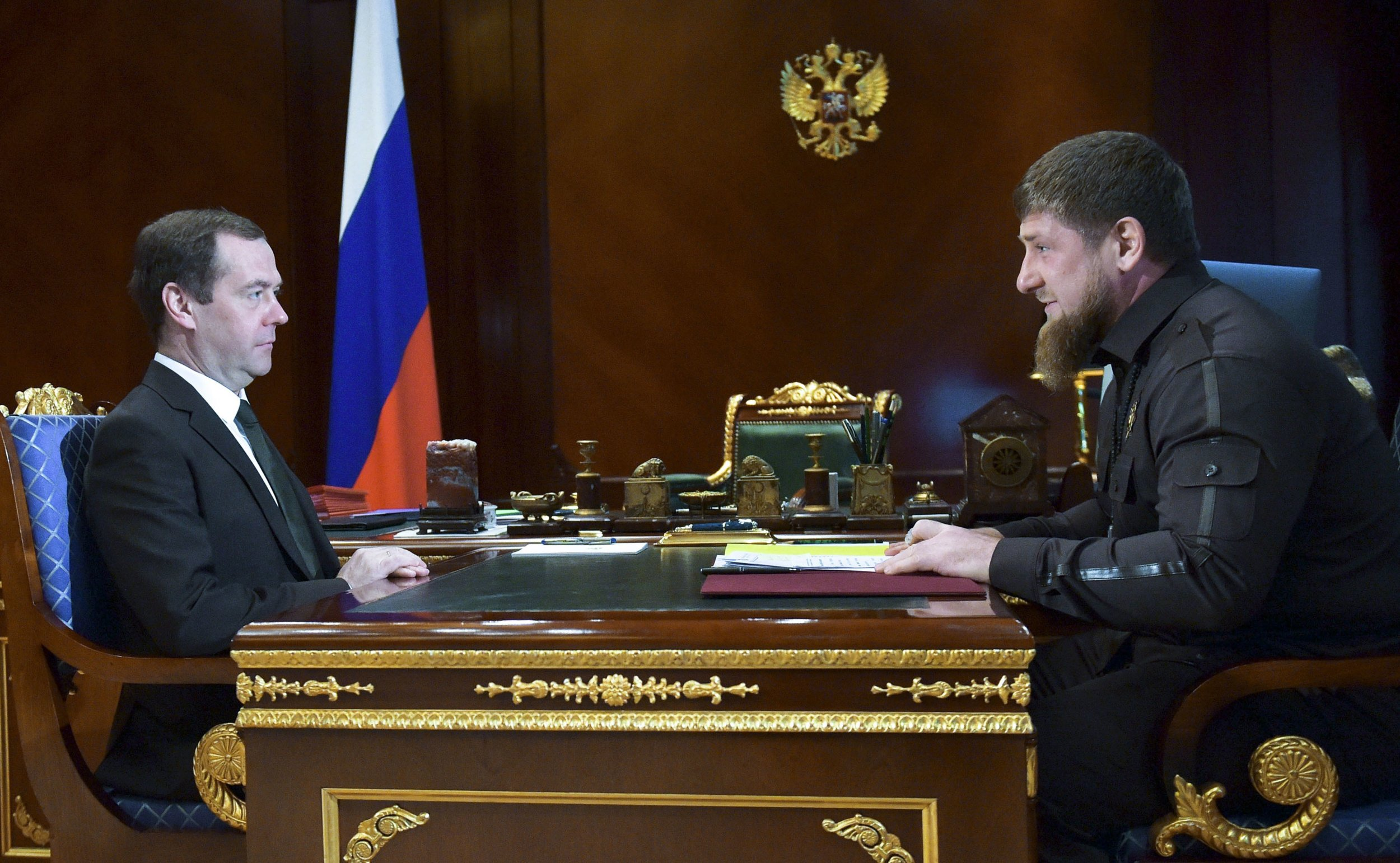 Russian Prime Minister Dmitry Medvedev, left, listens to Chechen regional leader Ramzan Kadyrov during their meeting in the Gorky residence outside Moscow, Russia, Thursday, March 30, 2017. (Alexander Astafyev, Sputnik, Government Pool Photo via AP)