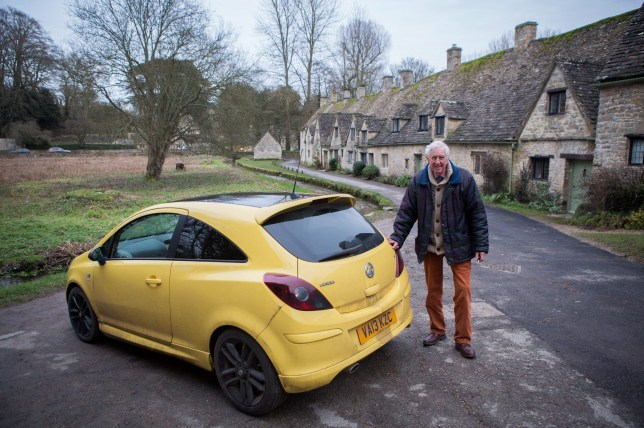 "FILE PIC - Peter Maddox who lives and parks his car in Arlington Row in Bibury - one of the most picturesque parts of the Cotswolds. See SWNS story SWYELLOW; Hundreds of yellow cars flooded a Cotswold village today (Sat) in support of an OAP whose canary motor was branded an 'eyesore'. Peter Maddox, 84, had to scrap his bright yellow car after vandals scrawled ""move"" on the bonnet and smashed in his windows causing £6,000 worth of damage. He had already been slammed by posh locals who said his vehicle was a blot on the rural idyll of Bilbury, Glos, After hearing about his plight hundreds of sympathisers in yellow descended on the village for a rally in support of Mr Maddox."