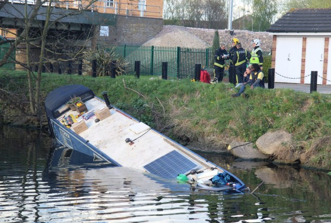 Mandatory Credit: Photo by REX/Shutterstock (8562296e) Fire crews at the scene as owner Heather and a male friend look on Houseboat sinks in the River Lea, Tottenhanham, London, UK - 01 Apr 2017
