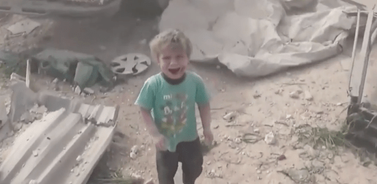 Syrian child videoed crying alone in bombed out village al