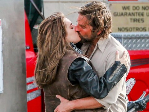 Lady Gaga steals a kiss from co-star Bradley Cooper on the set of A Star Is Born