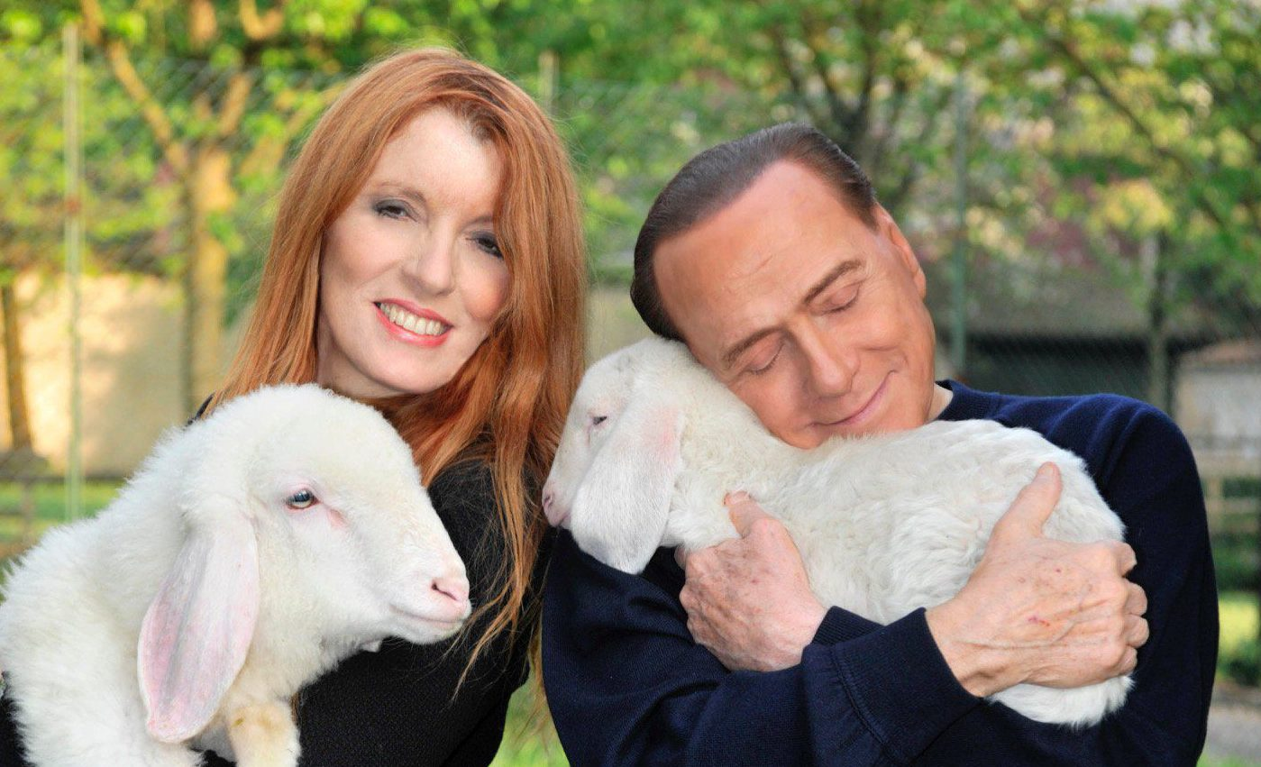 Berlusconi looks like he's preparing a lamb for a 'bunga bunga' party