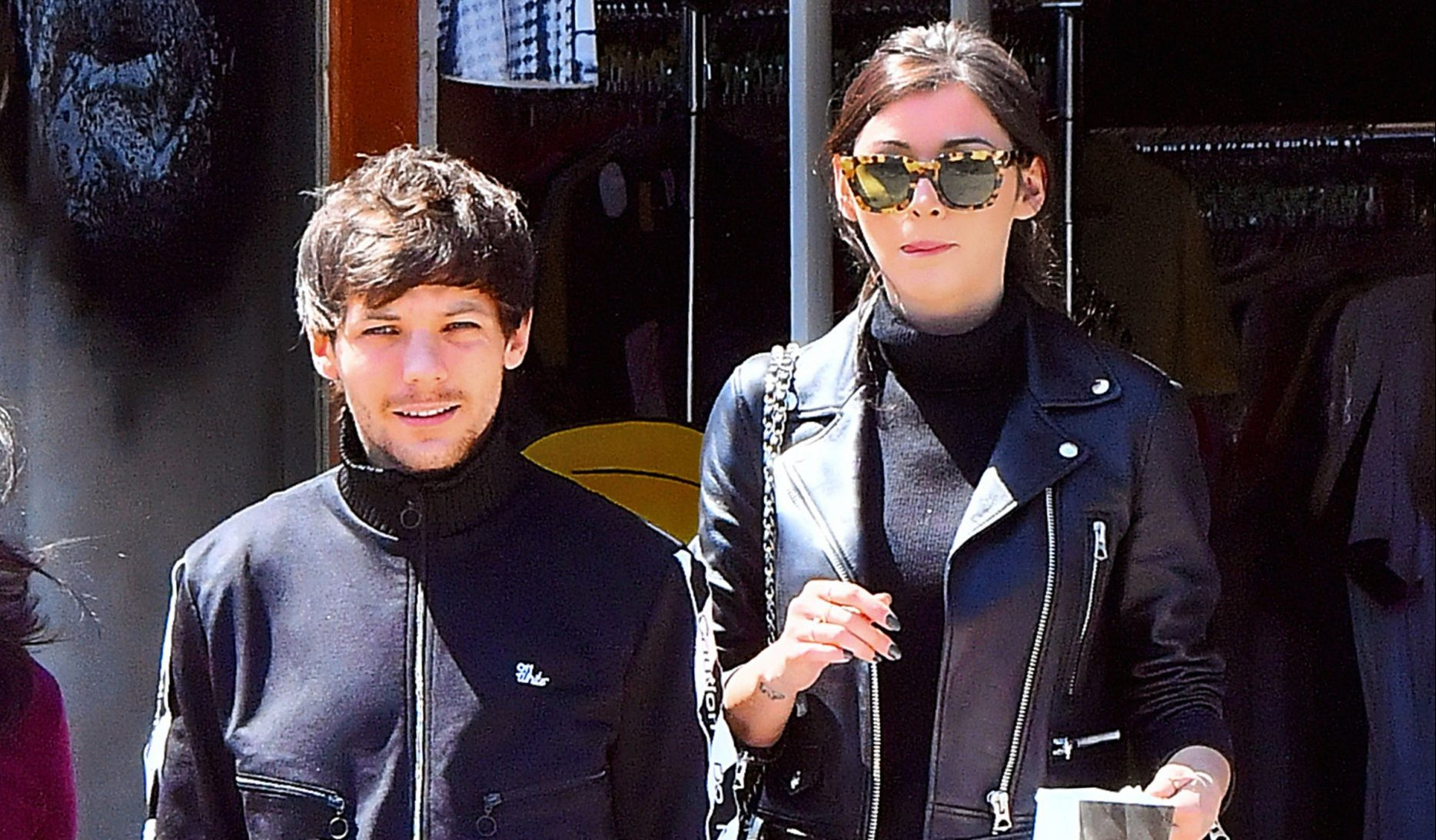 Louis Tomlinson and Eleanor Calder are twinning as couple are spotted for the first time since 'airport scuffle'