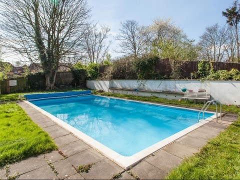 Flat for sale at £300,000 with swimming pool twice the size of the property