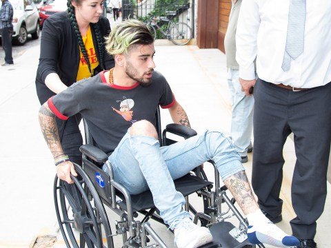 What's happened to Zayn Malik? Star arrives at Gigi Hadid's flat in a wheelchair as mystery injury leaves him unable to walk