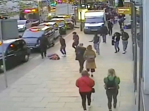 Woman filmed being knocked out in the street by total strangers