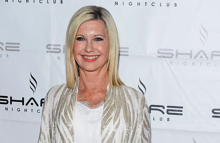 Olivia Newton-John reveals breast cancer has returned and spread to her backas she postpones tour to receive treatment