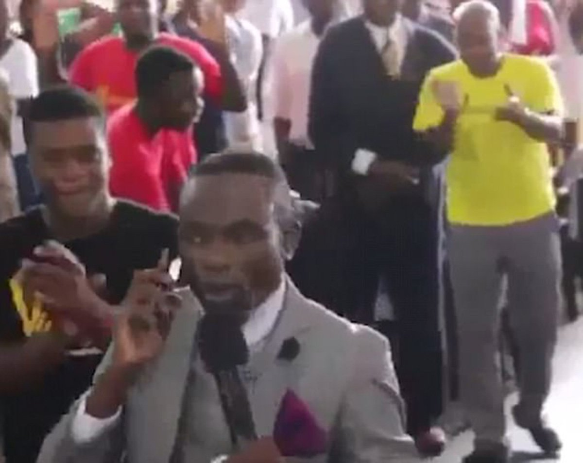 Pastor 'calls God on his mobile' during bizarre church service