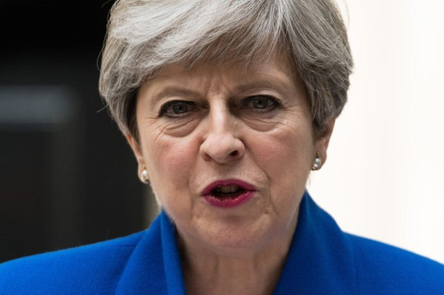 British Prime Minister and leader of the Conservative Party Theresa May delivers a speech outside number 10 Downing Street in London