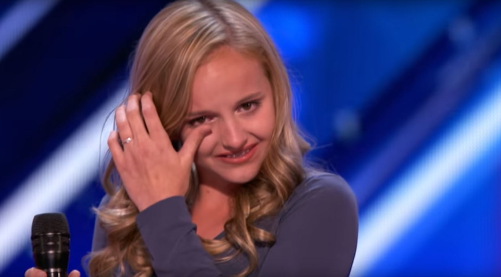 Brave 13-year-old girl brings America's Got Talent audience to tears by dedicating song to father battling stage four cancer