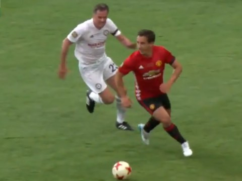 Jamie Carragher delivers on promise and 'snaps' Gary Neville during Michael Carrick's testimonial
