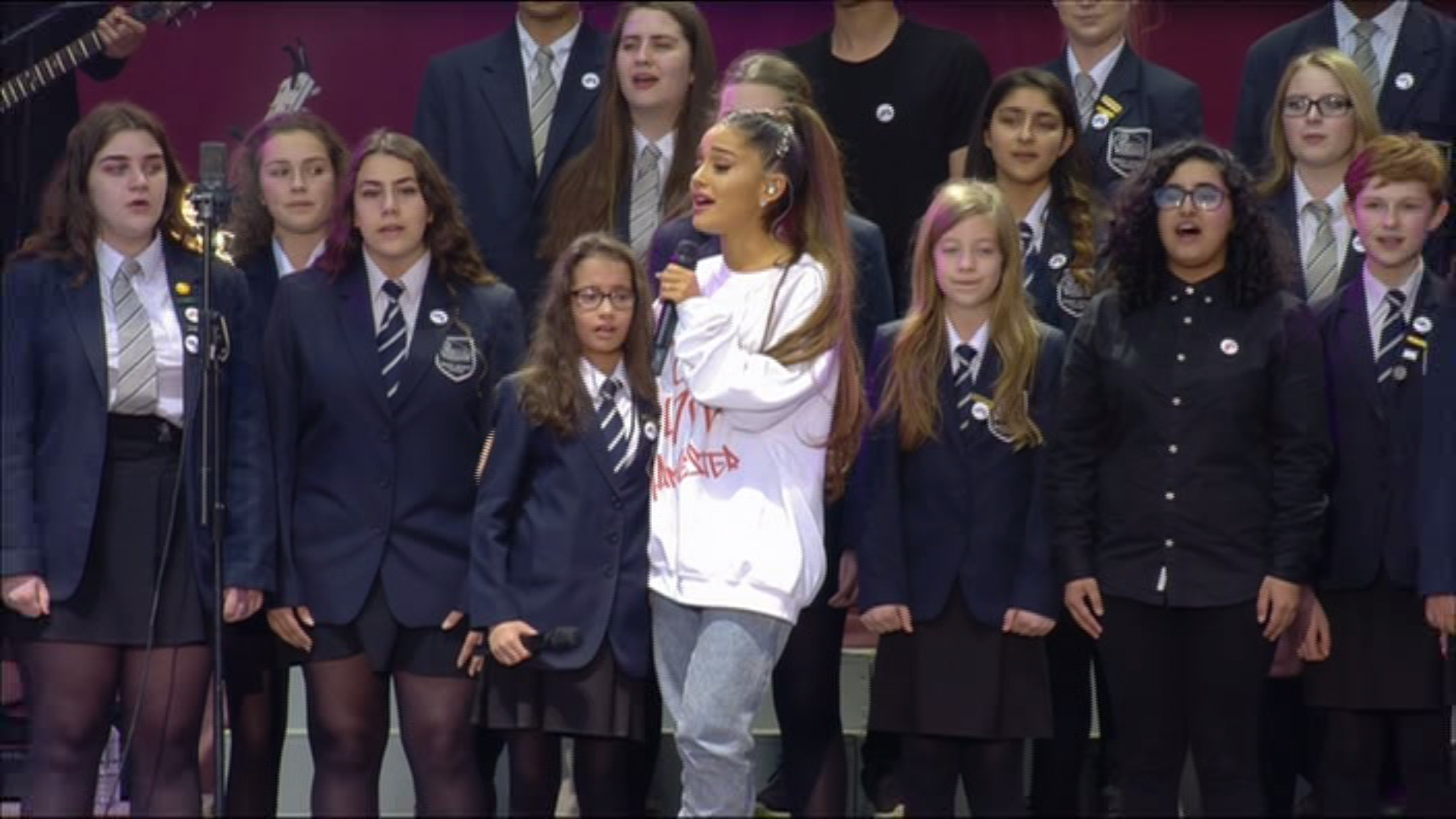 Ariana Grande comforts young teen as she breaks down in tears at One Love Manchester