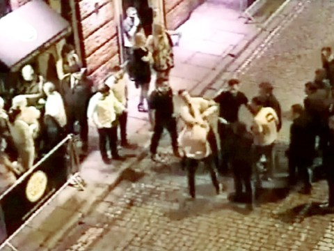 Football fans clash in shocking CCTV footage filmed outside nightclub