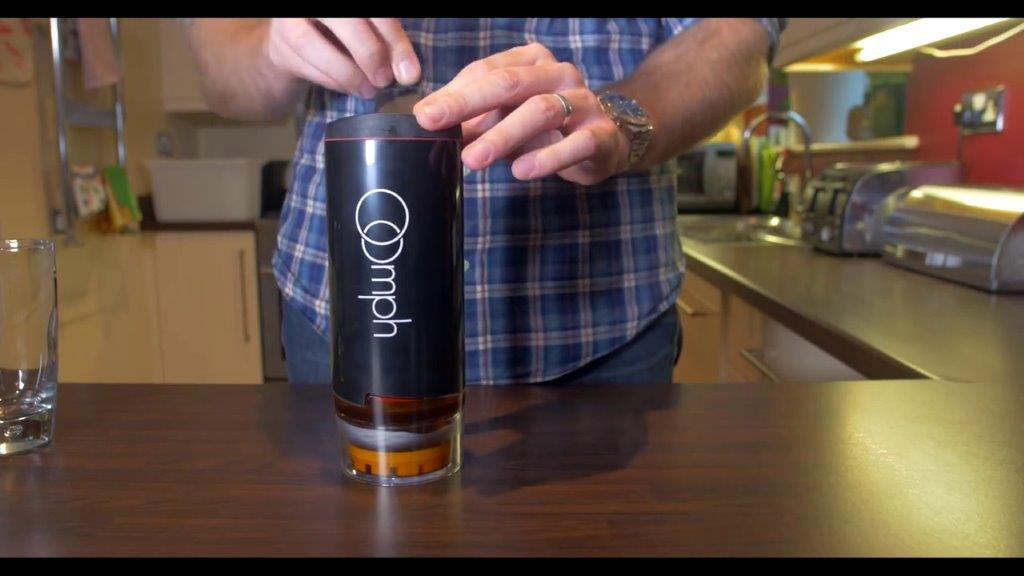 This insanely clever travel mug actually brews your coffee on the go
