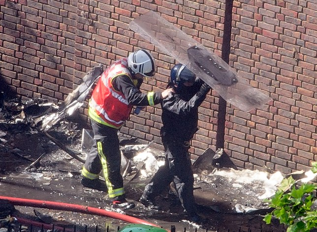 Grenfell Tower fire: Riot police protect firemen with