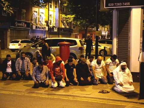 Group of Muslim men gather to pray at scene of Finsbury Park attack