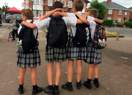 Schoolboys show up to school in skirts in protest over