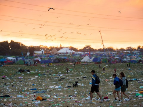 Epic clean up begins at Glastonbury Festival while revellers wade through fields of rubbish to make their way home