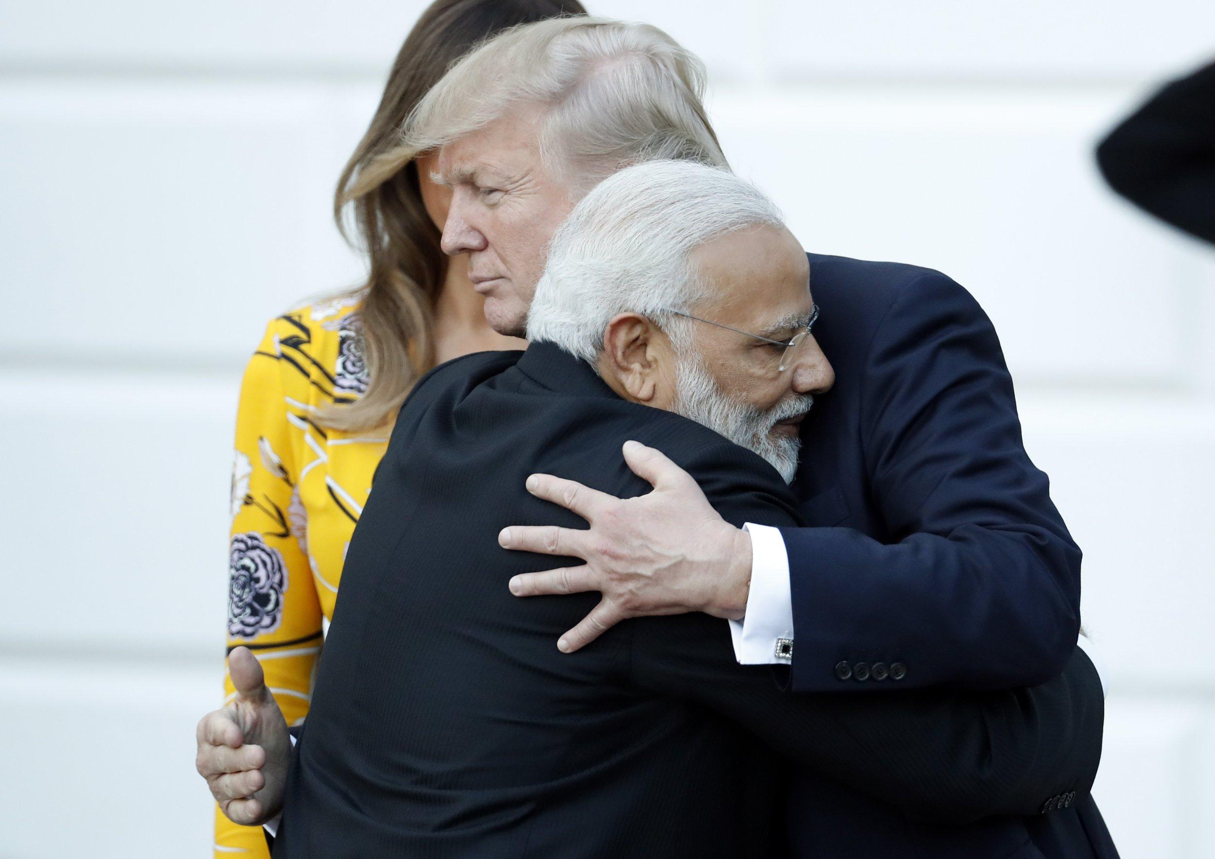 Indian Prime Minister Narendra Modi hugs President Donald Trump, with first lady Melania Trump behind, as Modi departs the White House, Monday, June 26, 2017, in Washington. (AP Photo/Alex Brandon)