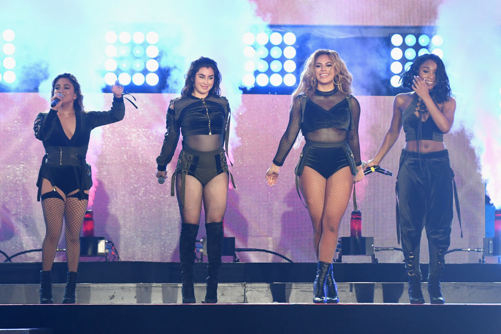 Fifth Harmony have surprised a super fan by singing to him at his desk