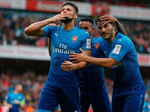 Olivier Giroud hints at Arsenal stay by tapping badge during goal celebration against Benfica