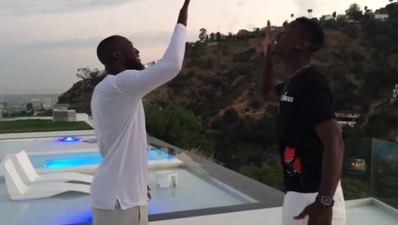 Romelu Lukaku celebrates with Paul Pogba after Manchester United confirm transfer