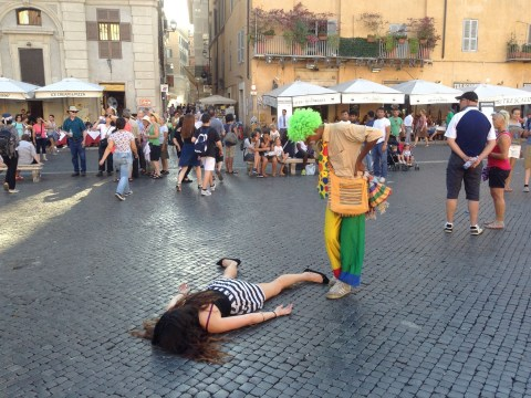 Artist keeps pretending to be dead in a protest against selfies