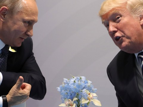 Putin outright denies election meddling as he and Trump look cozy in first meeting