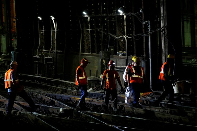 Amtrak track workers work inside the tunnel at New York's Penn Station, the nation's busiest train hub, which will be closing tracks for repairs causing massive disruptions to commuters in New York City, NY, U.S. July 7, 2017. REUTERS/Brendan McDermid