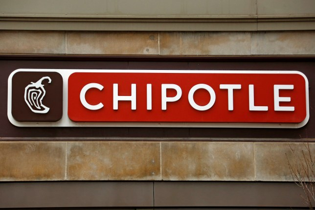 This Thursday, Jan. 12, 2017, photo shows a sign on a Chipotle restaurant. Chipotle says it temporarily shut down a restaurant in Virginia, on Monday, July 17, 2017, after becoming aware of reports of illnesses. The chain says it???s working to understand the cause, but that the reported symptoms are consistent with norovirus. The company says it plans to reopen the location in Sterling, Va., after a ???complete sanitization??? later on Tuesday, July 18, and that its food is safe to eat. (AP Photo/Gene J. Puskar)