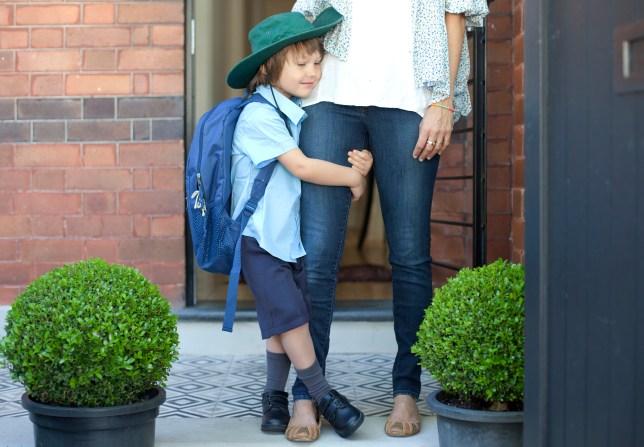 kid holding on to mum