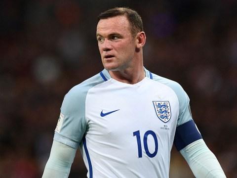England captain Wayne Rooney retires from international football