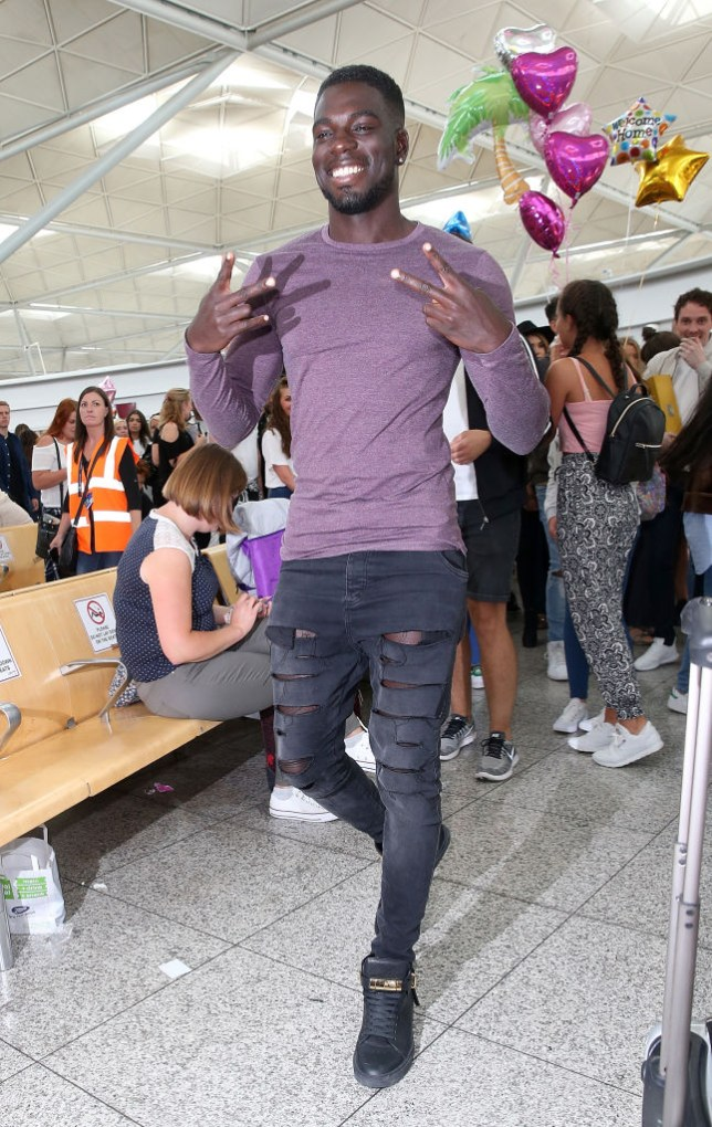 Love Island's Marcel Somerville walking through Stansted airport
