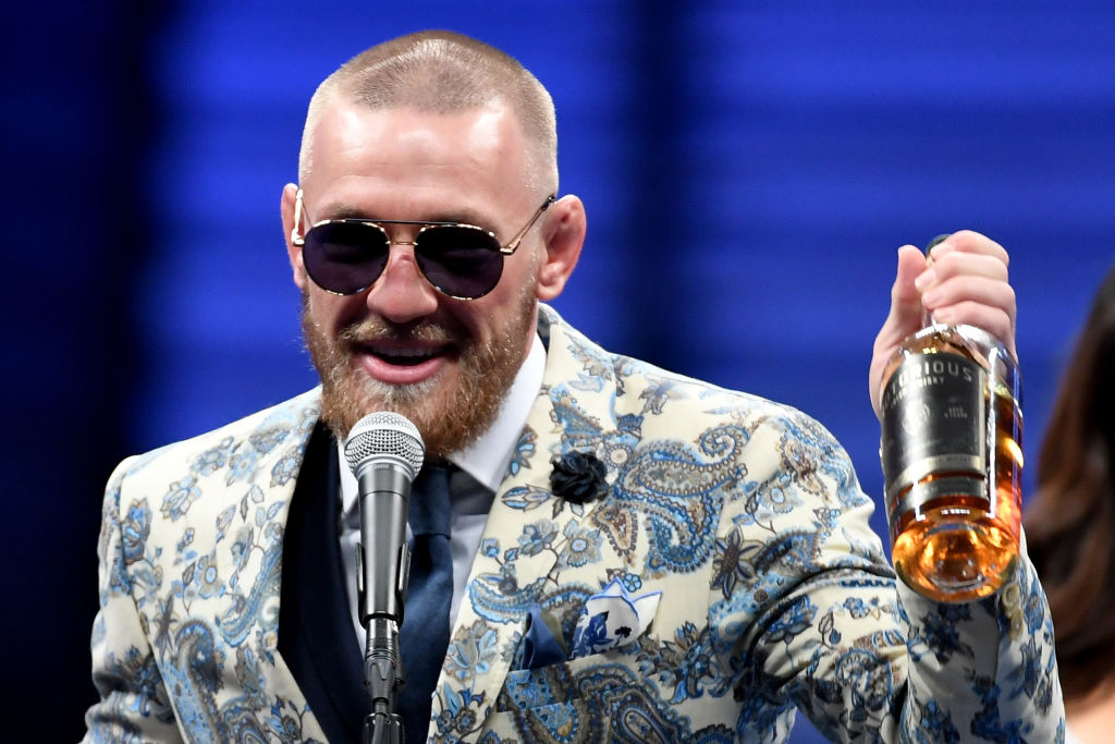 Conor McGregor rocks up to post-fight conference with bottle of 'Notorious' whiskey