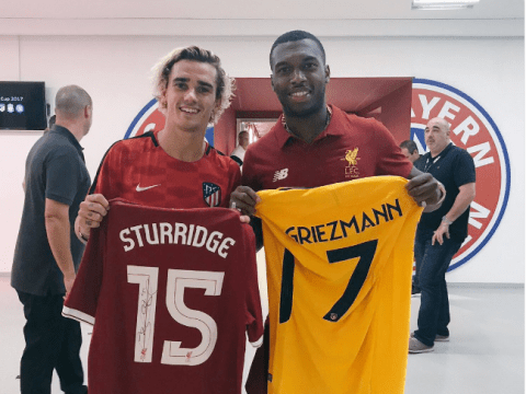 Manchester United fans rage as Antoine Griezmann is pictured holding a Liverpool shirt